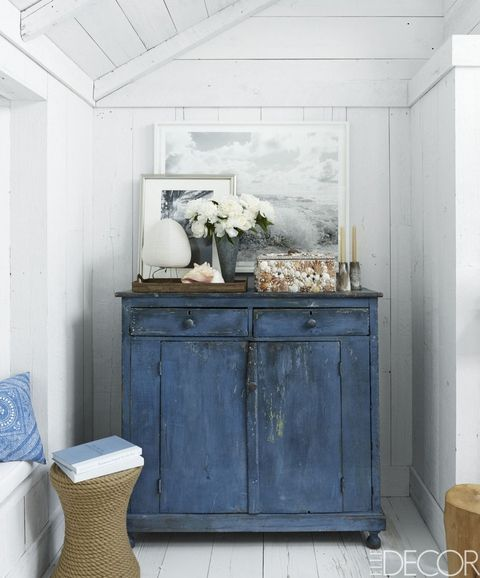 a colorful shabby chic cabinet is another great idea for storage in an awkward corner
