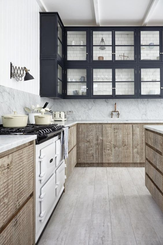 a creative space with black glass cabinets and reclaimed wood lower ones, vintage appliances and subway tiles on the wall