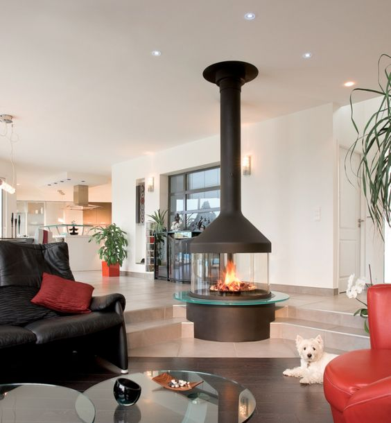 a modern glass fireplace is a stunning feature for the whole open space