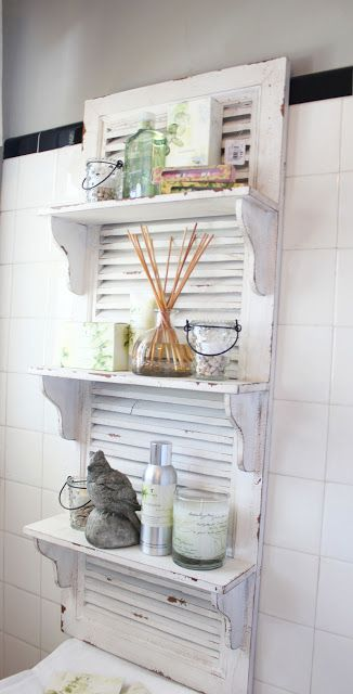 a white shutter is a nice base for a bathroom shelf and is very functional piece