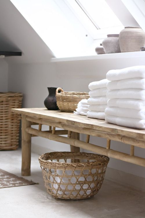 a wooden bench and some baskets for storage will add a spa feel to your bathroom