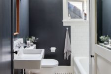 22 black walls and white tiles contrast and make a cool and eye-catchy space