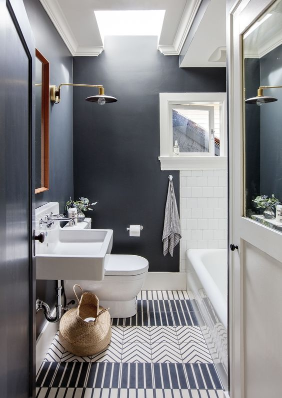 black walls and white tiles contrast and make a cool and eye-catchy space