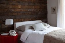 23 a dark reclaimed wooden wall adds a bold touch and texture to the modern bedroom