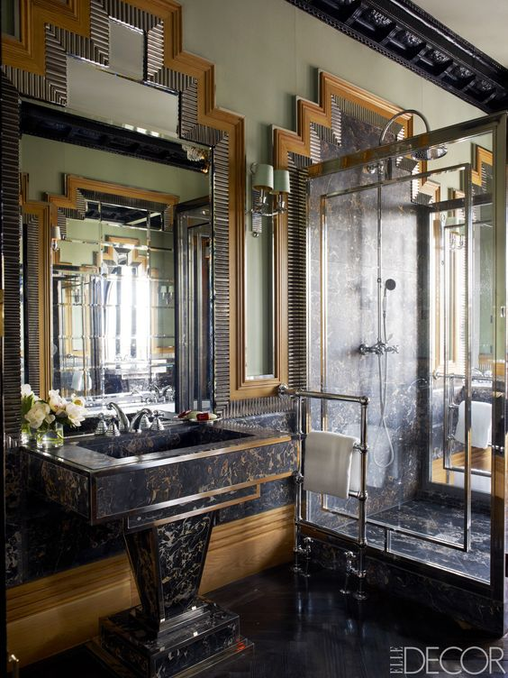 creative panels on the walls and floor, silver details and brass touches to make the room cool