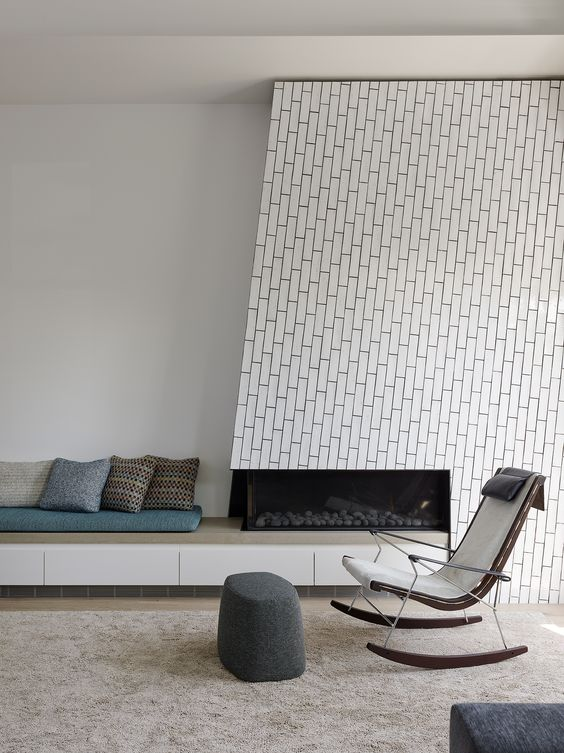 white tiles that imitate bricks and are clad using an eye-catchy pattern are amazing