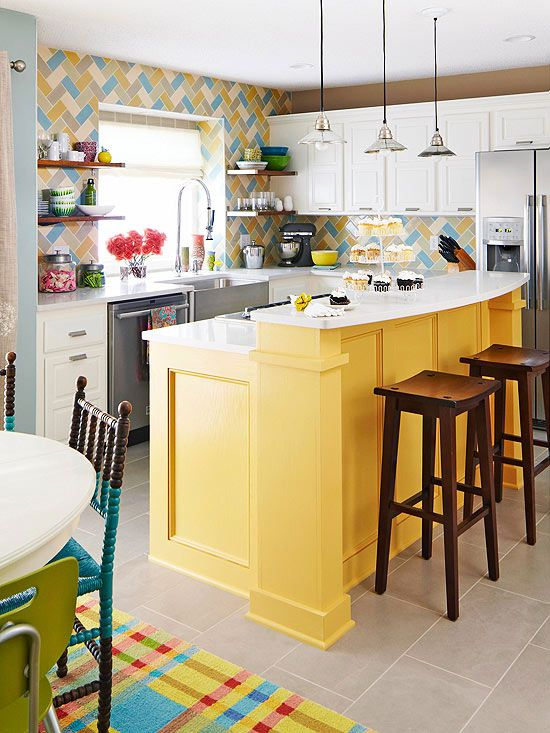 a colorful kitchen with a yellow two-level island that includes a breakfast zone