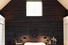 24 a fantastic cabin bedroom with a black wooden wall for a bold statement in a neutral space