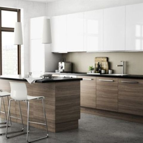a minimalist ktichen with white uppers and natural wood cabinets and a matching kitchen island and a neutral backsplash