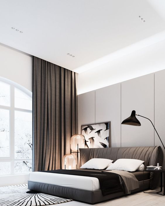 a modern bedroom with an upholstered brown bed and matching curtains, and cool large glass sphere lamps on one side