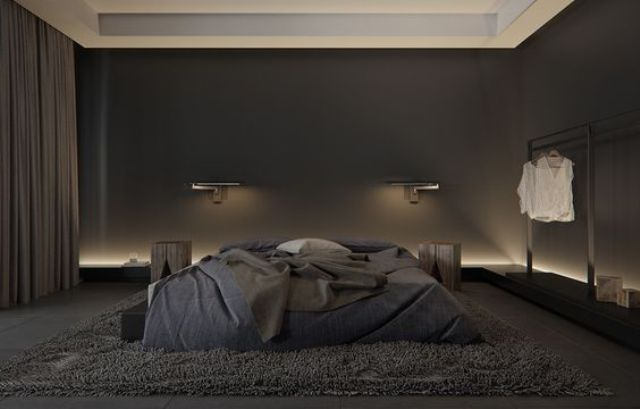 a modern masculine bedroom with a large bed and all black and graphite grey, additional lights make it brighter