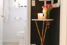 24 a tiny side table with a candle, lamp and soem fresh blooms on metallic legs is ideal for a tiny corner