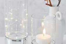 24 clear glass hurricanes can be used to display candles and LED lights to make your space cozier