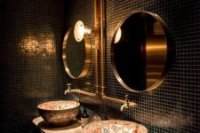 24 glossy black tiles with contrasting grout make the space refined, and brass touches add chic