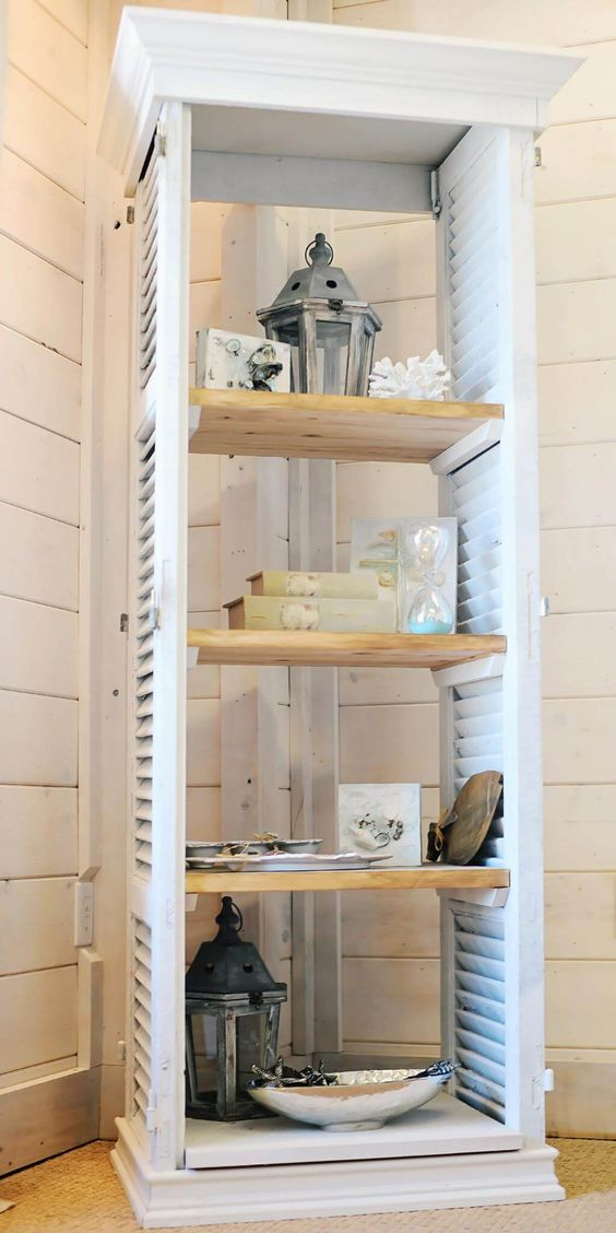 window shutters turned into a comfy shelving unit is great for any farmhouse space