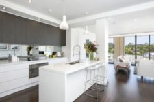 25 a minimalist space with white and dark stained wooden cabinets and a white kitchen island looks sleek and chic