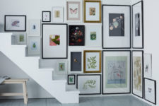 25 a staircase corner is fully taken with artworks and looks very spectacular, what a great idea