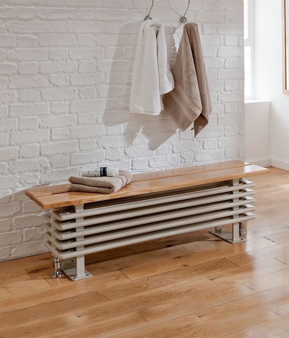 a radiator bench seat is a chic idea to hide it inside your bathroom and make the space usable