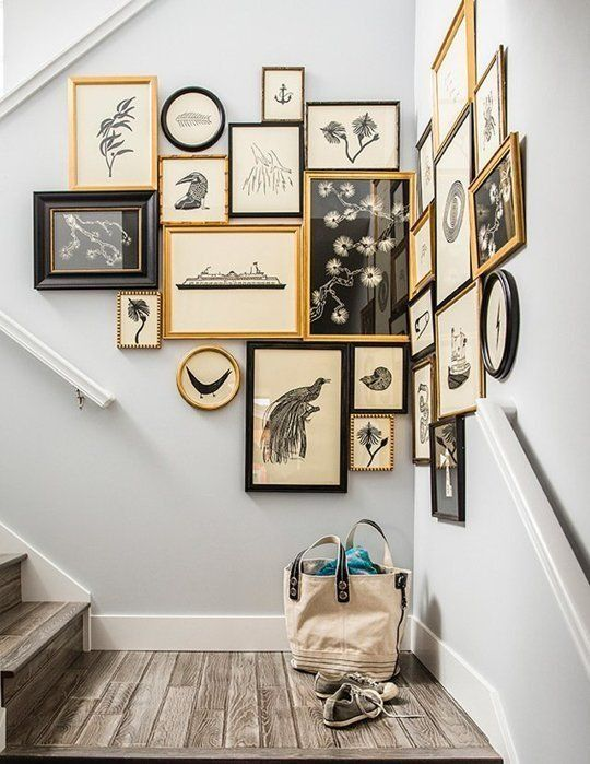 an awkward staircase corner with a gallery wall in gold, white and black for a cool and vintage-inspired look