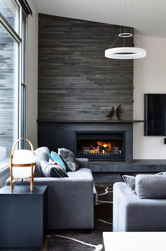 highlight your fireplace with weathered wood like here and some stone to make it stand out