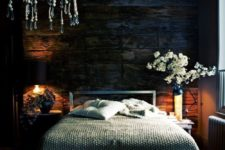 26 the base of this moody space is a very dark reclaimed wooden wall that sets the tone in the space
