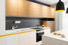 27 a modern kitchen with white and light-colored wooden cabinets and some black touches for an eye-catchy look