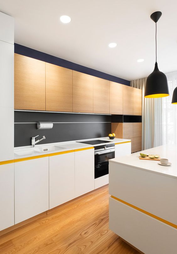a modern kitchen with white and light-colored wooden cabinets and some black touches for an eye-catchy look