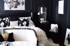 27 a refined space with black panel walls and creamy furniture looks wow, and vintage details make it gorgeous