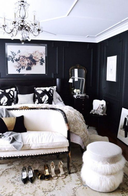 a refined space with black panel walls and creamy furniture looks wow, and vintage details make it gorgeous