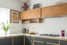 28 graphite grey and wooden cabinets are tied with the help of wooden framing on the grey lower cabinets