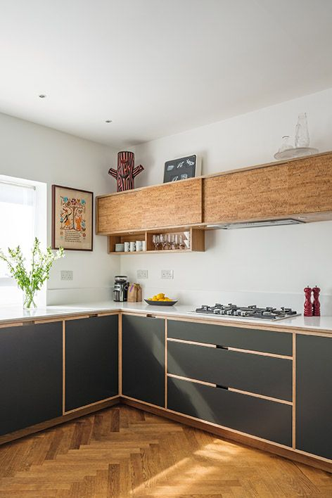 graphite grey and wooden cabinets are tied with the help of wooden framing on the grey lower cabinets