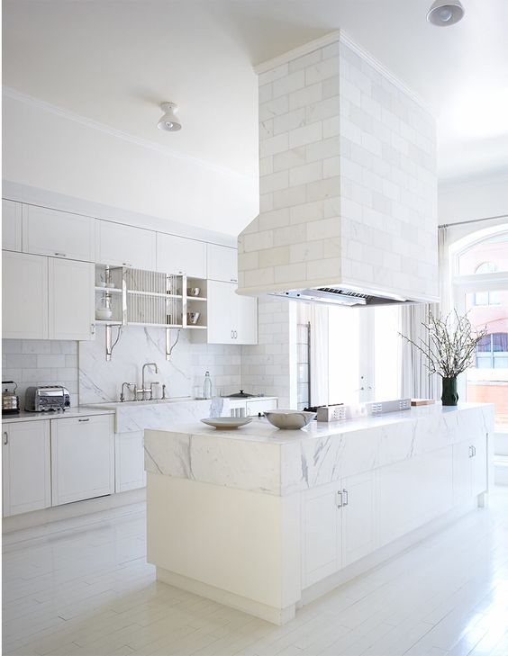 a white kitchen is added with a tile clad hood and backsplash and marble surfaces