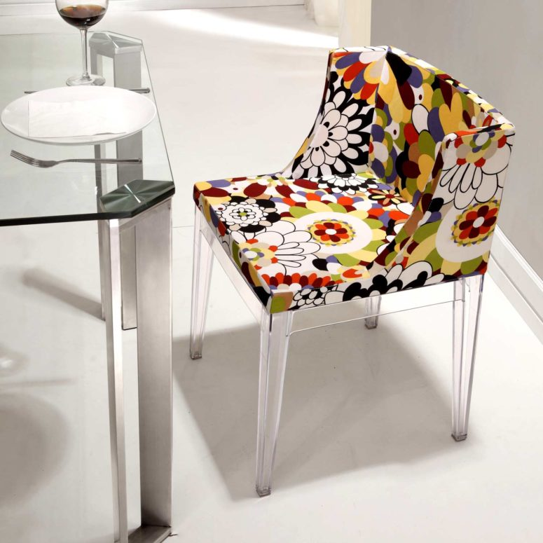 Pizzaro dining chair is a floral piece with acrylic legs and frame and is inspired by 1960s