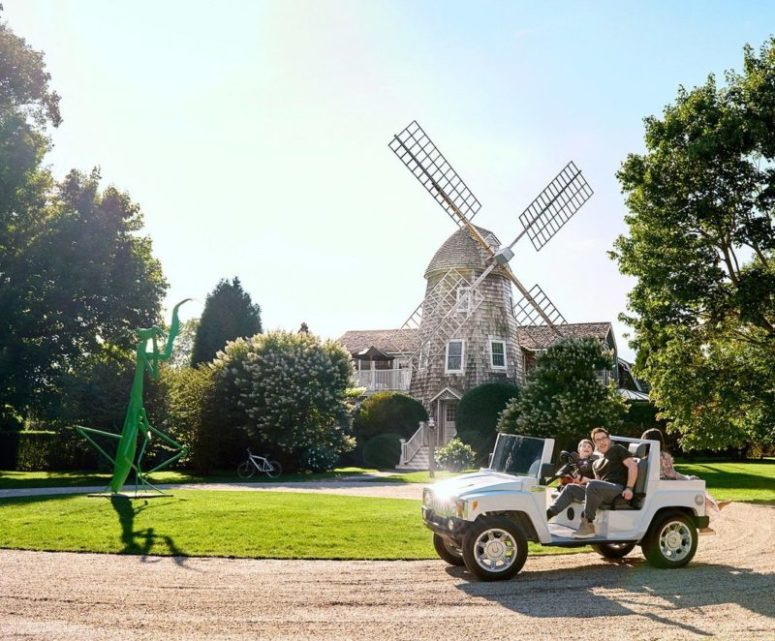The Windmill House with a 15 foot praying mantis statue on the front lawn