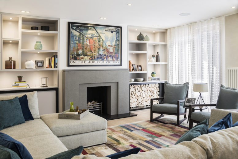 01-The-living-room-on-the-third-floor-looks-very-welcoming-with-colorful-touches-and-a-stone-fireplace-775x517 Inviting And Welcoming Seven-Storey Townhouse