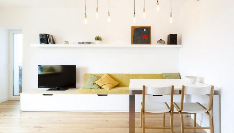 This chic apartment was done in minimalist style, with an airy feel and colorful touches