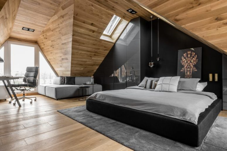 This chic attic space is a masculine bedroom that belongs to a young lawyer, who is a bachelor