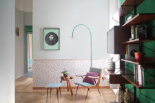 01 This colorful space is done with a green statement wall, colorful wallpaper and lots of floating shelves and drawers