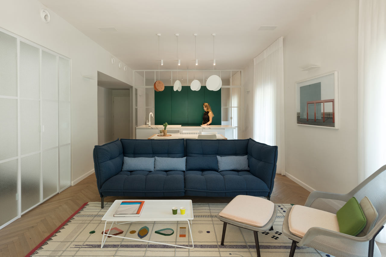 This modern apartment is renovated in a 1930s Bauhaus building and it got a chic modern look and was filled with light