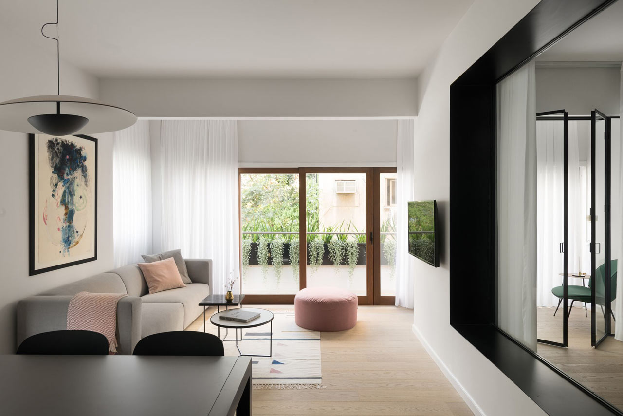 This modern apartment was created for a young family with two children, it's full of muted shades and simple and modern furniture