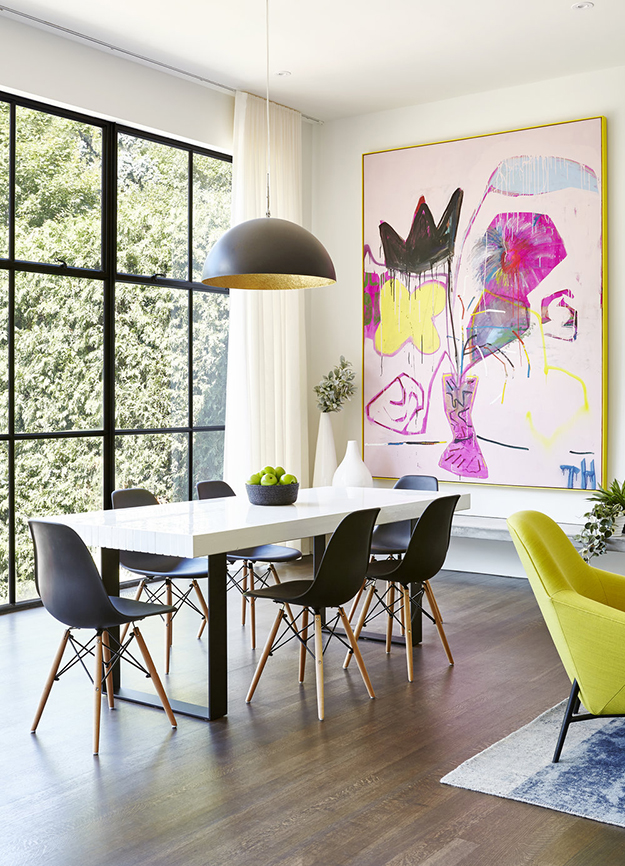 This modern dining space with a bold artwork and gorgeous views looks wow