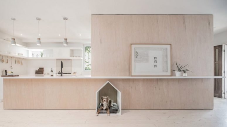 01-This-modern-home-features-a-plywood-cube-right-in-the-center-with-a-god-space-incorporated-and-this-dog-bed-became-a-focal-point-775x436 Modern Home With A Dog Bed As A Focal Point