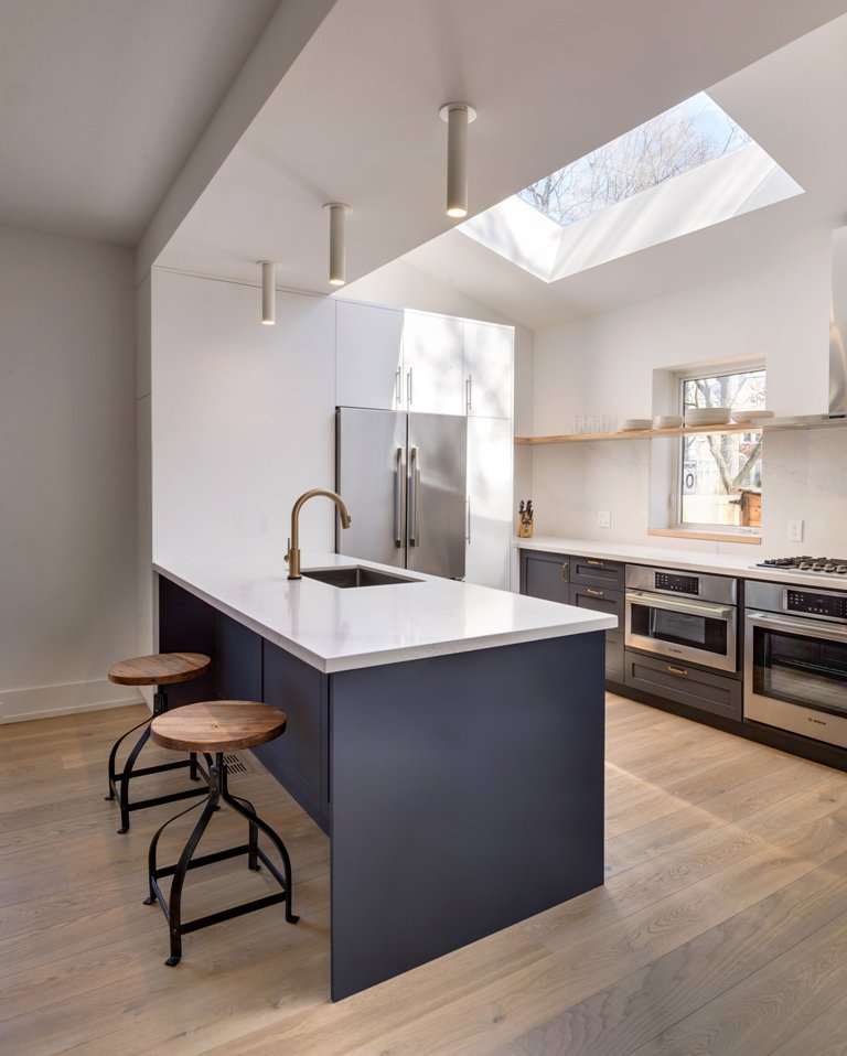 Skylights bring more natural light to the kitchen, industrial stools are great for the breakfast space
