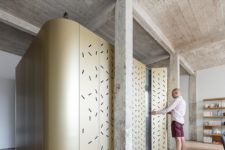 02 The designers added industrial chic with a concrete ceiling and pillars and perforated panels bring much light in