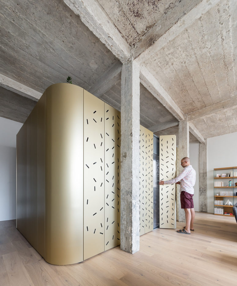 The designers added industrial chic with a concrete ceiling and pillars and perforated panels bring much light in