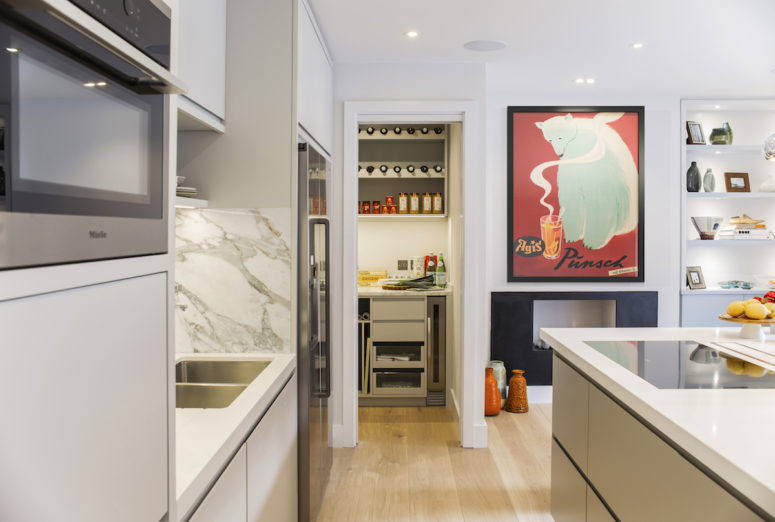The kitchen was moved to another floor and it features much functional storage
