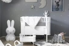 02 a beautiful grey nursery with a sky theme, paper pompoms and a stuffed cloud, moon and star