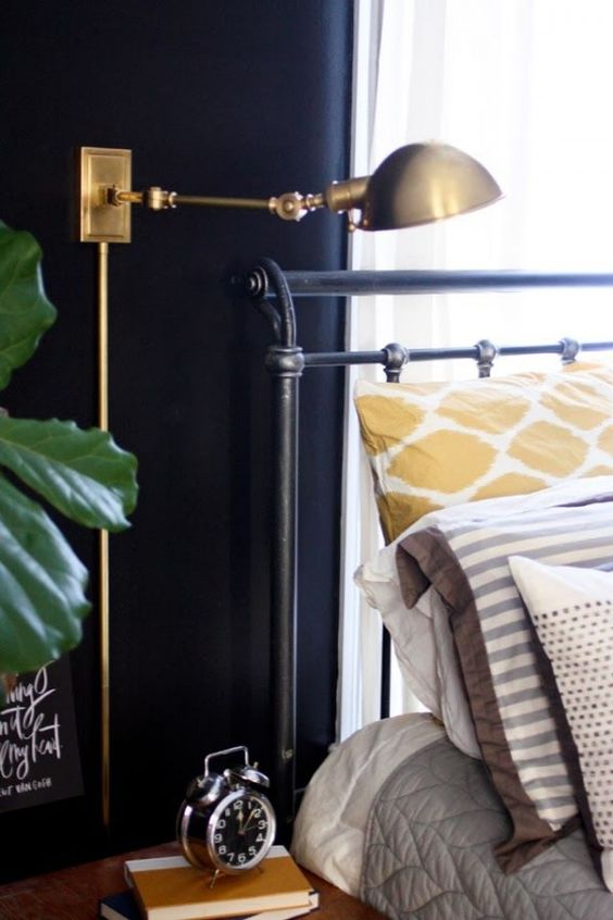 a chic vintage industrial wall sconce in brass will make an accent in any bedroom