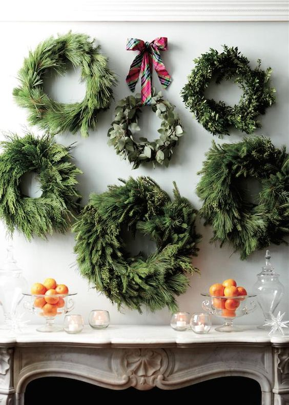 a gallery of wall wreaths to highlight your mantel or home bar at the party