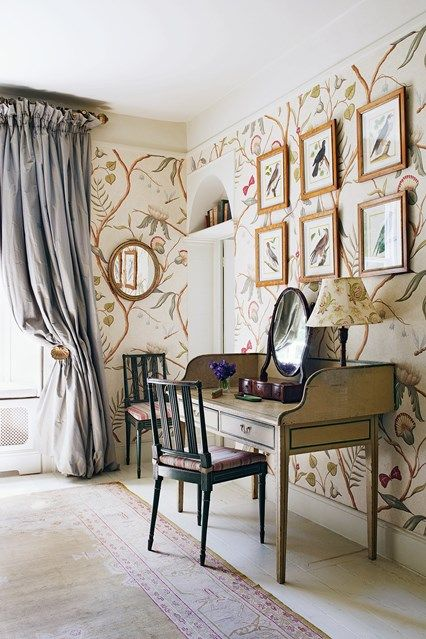 a gorgeous vintage-inspired home office with floral wallpaper in light shades